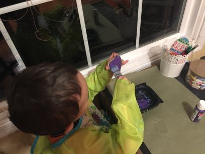 Lil' Man applying the base coat for Gangar.