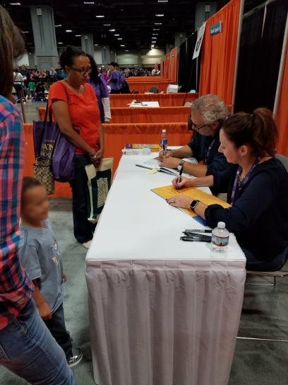 Lil' Man getting his book signed by Sherri Duskey Rinker.